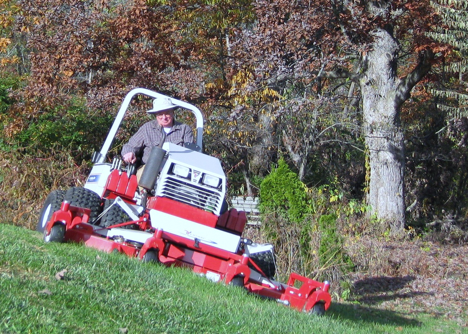 Ventrac contour mower mowing 28 degree slope